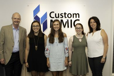 """Custom MMIC's President and CEO, Paul Blount (far left), and his wife, Kate Blount (far right), present inaugural """"Women in Engineering"""" scholarships to Sarah McKinley, Emma Fournier, and Grace Remillard (left to right)."""